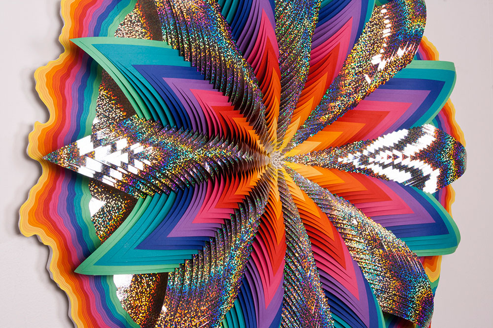Jen Stark - Glow, 2013, acid-free paper, holographic paper, glue, wood, acrylic paint, 63 x 40 x 4 in