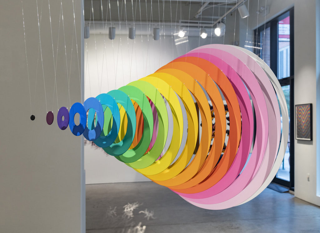 Gradial Continuum, 2019, mirrored stainless steel, monofilament & acrylic paint, 36 x 36 x 48 in.